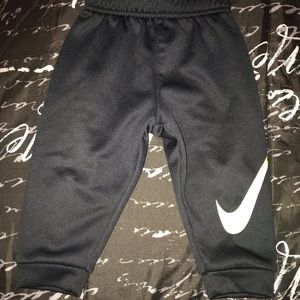 2 dry fit Nike shirts and jogger pants. Baby size